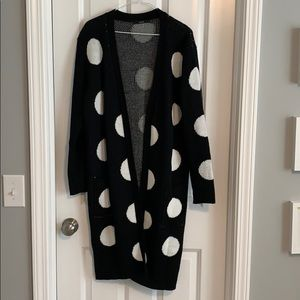 Black sweater with white polka dots